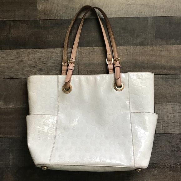 dda7a1b10ec7cd Michael Kors Large Patent Leather Set Tote Bag. M_5b6e538bdcf855e700f64b81
